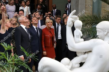 French President Emmanuel Macron (3rdL), his wife Brigitte Trogneux (C), Museum's Director Christine Buhl (L) and French Ambassador to Denmark Francois Zimeray (2ndL) visit the Glyptotek museum, Copenhagen