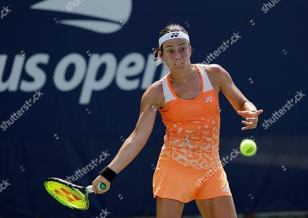 Anastasija Sevastova, of Latvia, returns the ball to Claire Liu during the second round of the U.S. Open tennis tournament, in New York
