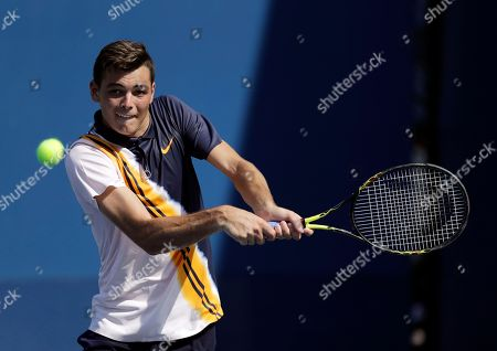 Taylor Fritz returns the ball to Jason Kubler, of Australia, during the second round of the U.S. Open tennis tournament, in New York