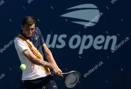 Taylor Fritz returns a shot to Jason Kubler, of Australia, during the second round of the U.S. Open tennis tournament, in New York