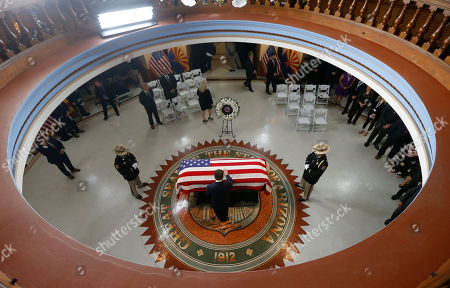Arizona Cardinals President, Michael Bidwill pays his respects at the casket of Sen. John McCain, R-Ariz. during a memorial service at the Arizona Capitol, in Phoenix, Arizona, USA, 29 August 2018. The senator died from brain cancer in Sedona, Arizona, USA on 25 August 2018. McCain a veteran of the Vietnam War, served two terms in the US House of Representatives, and was elected to five terms in the US Senate. He also ran for president twice, and was the Republican nominee in 2008.