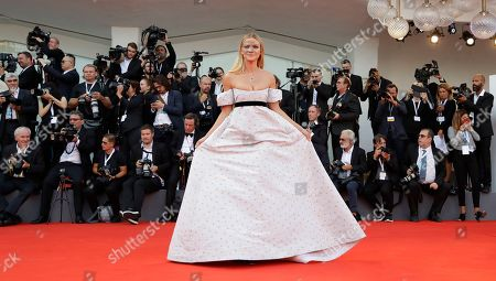 Television Presenter Fiammetta Cicogna poses for photographers at the premiere of the film 'First Man' and the opening Ceremony of the 75th edition of the Venice Film Festival in Venice