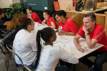 IMAGE DISTRIBUTED FOR MACY'S - Jeff Gennette, right, Macy's, Inc. Chairman & Chief Executive Officer, mentors youth at a job training program at GrandLo Cafe at Grand Street Settlement on in New York. Give Back Day brings together an army of over 400 Macy's & Bloomingdale's volunteers in New York City for an impactful day of community service