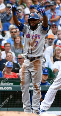 New York Mets' Jose Reyes (7) reacts after hitting a two-run triple during the seventh inning of a baseball game against the Chicago Cubs, in Chicago