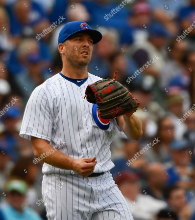 Chicago Cubs relief pitcher Brandon Kintzler (20) reacts after New York Mets' Jose Reyes (7) hit a two-run triple during the seventh inning of a baseball game, in Chicago