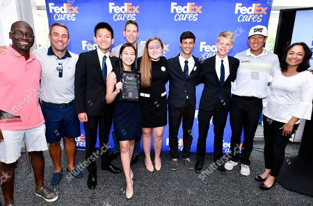 Stock Image of From left, Emcee Michael Holley, NBC Sports broadcaster Boston, and panelists Taylor Twellman, ESPN Soccer Analyst and former New England Revolution Player, Jeremy Ford, Director Charitable Giving, Dell Technologies, James Hahn, two-time PGA TOUR tournament winner, Manasi Gangan, Nested Bean founder and President and FedEx Small Business Winner, pose with the JA of Northern New England students who created Alchemy Apparel, a business which seeks to provide a platform for local artists by featuring their artwork on fresh and exclusive clothing, were the winners of the FedEx Junior Business Challenge at the Dell Technologies Championship on in Norton, Mass. Alchemy Apparel will join JA students from three other qualifying events held at PGA TOUR tournaments this season at the TOUR Championship for the chance to generate a $75,000 donation from FedEx to their local JA chapter