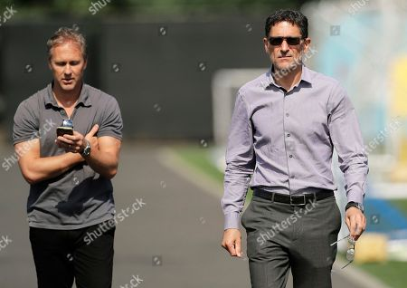Seattle Sounders majority owner Adrian Hanauer, right, walks with sporting director Chris Henderson, as they prepare to talk to reporters, following MLS soccer training in Tukwila, Wash. Sounders forward Clint Dempsey announced his retirement Wednesday, stepping away at age 35 after 15 years of playing soccer professionally