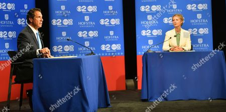 New York Gov. Andrew M. Cuomo speaks at the Democratic gubernatorial primary debate as his challenger, Cynthia Nixon, listens, at Hofstra University in Hempstead, N.Y. The winner of the Democratic primary faces Republican Marc Molinaro and independent Stephanie Miner in November 2018