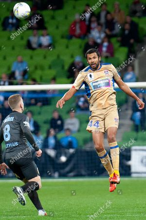 Newcastle Jets defender Nikolai Topor-Stanley (44) headers the ball away from Melbourne City midfielder Riley McGree (8) at the FFA Cup Round 16 soccer match