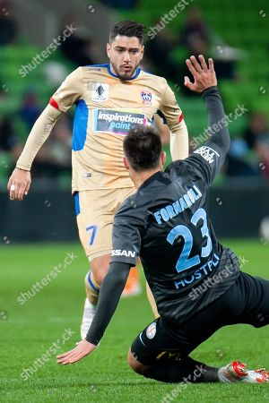 Melbourne City forward Bruno Fornaroli (23) defends the ball against Newcastle Jets forward Dimitri Petratos (7) at the FFA Cup Round 16 soccer match