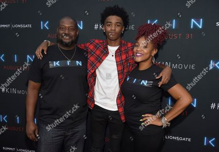 """Myles Truitt, Monte Jackson, Danielle Jackson. Myles Truitt, center, and his parents Monte Jackson, left, and Danielle Jackson arrive at the Los Angeles premiere of """"Kin"""" at ArcLight Hollywood on"""