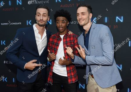 """Josh Baker, Jonathan Baker. Directors Josh Baker, left, and Jonathan Baker, right, and actor Myles Truitt arrive at the Los Angeles premiere of """"Kin"""" at ArcLight Hollywood on"""