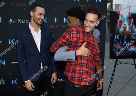 """Josh Baker, Jonathan Baker, Myles Truitt. Directors Josh Baker, left, and Jonathan Baker, right, greet actor Myles Truitt as they arrive at the Los Angeles premiere of """"Kin"""" at ArcLight Hollywood on"""