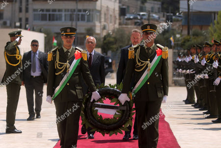 Chairman of the Tripartite Presidency of Bosnia and Herzegovina Bakir Izetbegovic lays a wreath at the tomb of late Palestinian leader Yasser Arafat, in the West Bank city of Ramallah