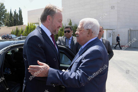 Chairman of the Tripartite Presidency of Bosnia and Herzegovina Bakir Izetbegovic is welcomed by Palestinian President Mahmoud Abbas during a reception ceremony in the West Bank city of Ramallah
