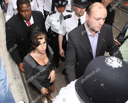 Amy Winehouse going for a fag outside court