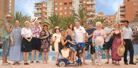 'Benidorm'  TV - 2009 - Troy (Paul Bazely), Gavin (Hugh Sachs), Janey (Crissy Rock), Donald (Kenny Ireland), Jacqueline (Janine Duvitski), Chantelle (Hannah Hobley), Janice (Siobhan Finneran), Mick (Steve Pemberton), Oracle (Johnny Vegas), Oracle's Mum (Elsie Kelly), Martin (Nicholas Burns), Kate (Abigail Cruttenden) and Mateo (Jake Canuso) Front Row - Madge (Sheila Reid) and Michael ( Oliver Stokes)