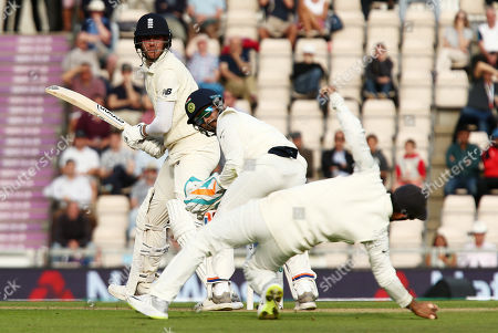 Stuart Broad of England edges the ball behind for four runs.