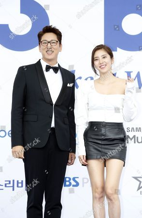 Stock Photo of South Korean MC and announcers Han Seok-jun (L) and South Korean singer and actress Son Dam-bi (R) pose as they arrive for the 'Soribada Best K-Music Awards 2018' at the Olympic park in Seoul, South Korea, 30 August 2018. The Soribada is a music company of South Korea and will hold an award ceremony named Soribada Best K-Music Awards.