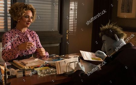 Stock Image of Maya Rudolph as Bubbles, Phil Philips (Bill Barretta)