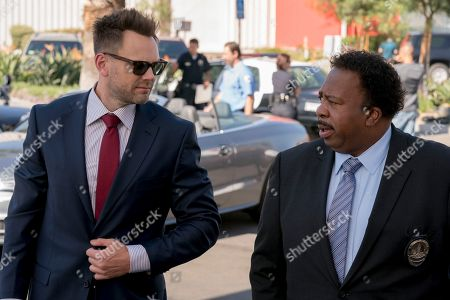 Stock Picture of Joel McHale as Agent Campbell, Leslie David Baker as Lt. Banning