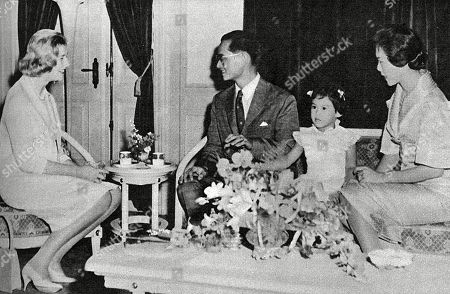 An Official State Visit to Thailand by Princess Alexandra of Kent (1926-) - Pictured with King Bhumibol Adulyadej (rama Ix) (1927-) and Queen Sirikit (1932-) of Thailand with Their Eldest Daughter Princess Ubolratana Rajakanya (1951-) at the Chitlada Palace in Bangkok. Unattributed Photograph in the Sphere October 10 1959 Issue - P47