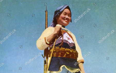 Stock Image of A Yi Militiawoman Belonging to One of China's Many Ethnic Minorities. the Yi (or Lolo) Live Mostly in Mountain Areas. . Photograph On A Postcard