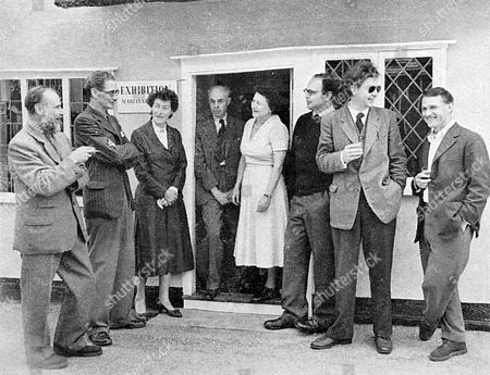 Distinguished Artist Inhabitants Exhibit Their Work at the Village Show in Great Bardfield. From the Left Are Clifford Smith; John Aldridge A.r.a.; Mrs John Crittall; Edward Bawden A.r.a.; Marianne Straub; Michael Rothenstein; Walter Hoyle and George Chapman. They Are Standing Outside Miss Straub's Cottage in Which Her Woven Textiles Are Displayed. . Unattributed Photograph in the Sphere, 16th July 1955, Page 103
