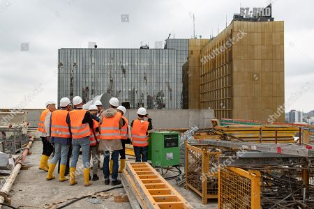 Journalists look around during a guided tour of the new Axel Springer building construction site in Berlin, Germany, 30 August 2018. The new building of Axel Springer, one of the biggest digital publishers in Europe that owns various multimedia news brands is designed by Dutch architect Rem Koolhaas.