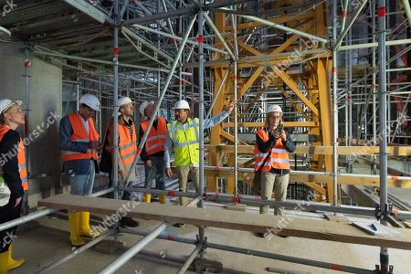 Andreas Ludwigs (2-R), Managing Director of Axel Springer Services & Real Estate GmbH speaks during a guided tour of the new Axel Springer building construction site in Berlin, Germany, 30 August 2018. The new building of Axel Springer, one of the biggest digital publishers in Europe that owns various multimedia news brands is designed by Dutch architect Rem Koolhaas.