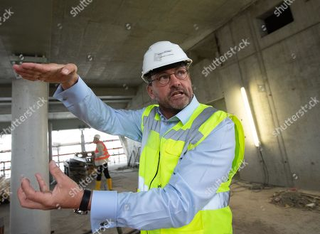 Andreas Ludwigs, Managing Director of Axel Springer Services & Real Estate GmbH speaks during a guided tour of the new Axel Springer building construction site in Berlin, Germany, 30 August 2018. The new building of Axel Springer, one of the biggest digital publishers in Europe that owns various multimedia news brands is designed by Dutch architect Rem Koolhaas.