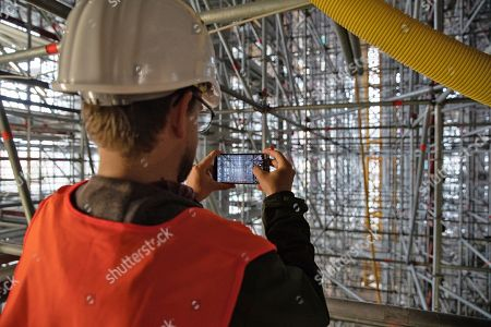 A journalist takes pictures during a guided tour of the new Axel Springer building construction site in Berlin, Germany, 30 August 2018. The new building of Axel Springer, one of the biggest digital publishers in Europe that owns various multimedia news brands is designed by Dutch architect Rem Koolhaas.