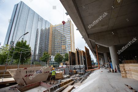 A view with the Axel Springer building in the background taken during a guided tour of the new Axel Springer building construction site in Berlin, Germany, 30 August 2018. The new building of Axel Springer, one of the biggest digital publishers in Europe that owns various multimedia news brands is designed by Dutch architect Rem Koolhaas.