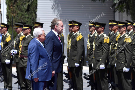 Palestinian President Mahmoud Abbas and Chairman of the Tripartite Presidency of Bosnia and Herzegovina Bakir Izetbegovic review the honor guard during a reception ceremony, in the West Bank city of Ramallah