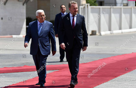 Palestinian President Mahmoud Abbas walks alongside with Chairman of the Tripartite Presidency of Bosnia and Herzegovina Bakir Izetbegovic during a reception ceremony in the West Bank city of Ramallah