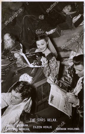Filming of the Movie 'Hamlet' at Denham (directed by and Starring Laurence Olivier) - Some of the 'Stars' Relaxing - Includes Charles Doran Terence Morgan Eileen Herlie (reading 'The Queen' Magazine) and Norman Wooland. Unattributed Postcard