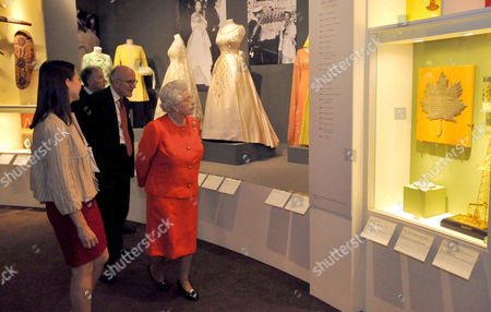 Queen Elizabeth II is shown around the exhibition by Sir Hugh Roberts, Director of the Royal Collection and Assistant Curator Caroline De Guitaut