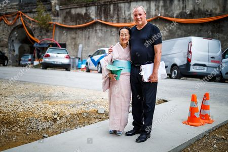"Setsuko Klossowska de Rola, widow of painter Balthus (L), and U.S. stage director Robert Wilson (R) pose before entering the ""Balthus Unfinished"" exhibition conceived by Robert Wilson in the ""Plateforme 10"" construction site that will regroup the Musee cantonal des Beaux-arts (mcb-a), the Musee de l?Elysee and the MUDAC in Lausanne, Switzerland, 30 August 2018. The exhibition puts on display unfinished artworks by Polish-French artist Balthasar Klossowski de Rolam, known as Balthus."