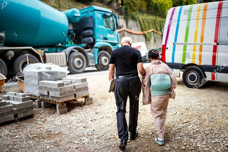 Setsuko Klossowska de Rola (R), widow of painter Balthus, and U.S. stage director Robert Wilson (L) walk towards the entrance of the 'Balthus Unfinished' exhibition that he conceived in the 'Plateforme 10' construction site that will regroup the Musee cantonal des Beaux-arts (mcb-a), the Musee de l?Elysee and the MUDAC in Lausanne, Switzerland, 30 August 2018. The exhibition puts on display unfinished artworks by Polish-French artist Balthasar Klossowski de Rolam, known as Balthus.