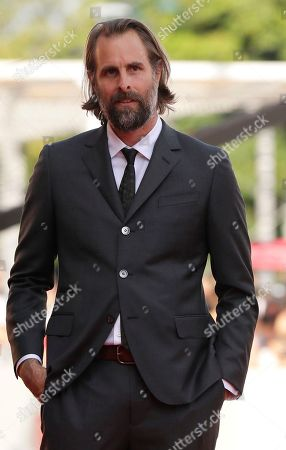 Director Rick Alverson poses for photographers upon arrival at the premiere of the film 'The Mountain' at the 75th edition of the Venice Film Festival in Venice, Italy