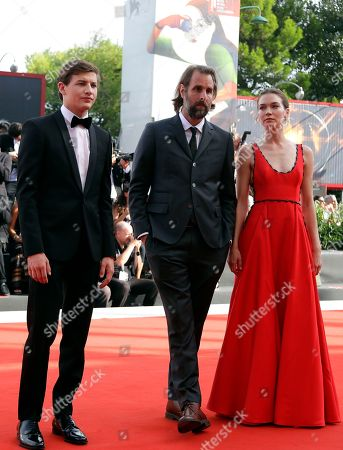 Director Rick Alverson, centre, stands with actors Tye Sheridan, left, and Hannah Gross upon arrival at the premiere of the film 'The Mountain' at the 75th edition of the Venice Film Festival in Venice, Italy