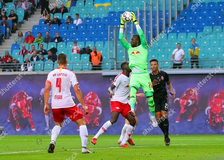 Leipzig's goalkeeper Yvon Mvogo (2-R) clears the ball during the UEFA Europa League playoff, second leg soccer match between RB Leipzig and FC Zorya Luhansk in Leipzig, Germany, 30 August 2018.