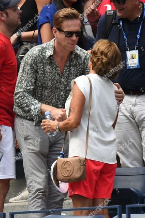 Damian Lewis embraces Lynette Federer, mother of Roger Federer.