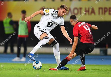 Rosenborg's Nicklas Bendtner (L) in action against Egzon Bejtulai (R) of Shkendija during the UEFA Europa League playoff, second leg soccer match between KF Shkendija and Rosenborg BK in Skopje, The Former Yugoslav Republic of Macedonia, 30 August 2018.