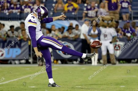 Stock Image of Minnesota Vikings punter Ryan Quigley kicks against the Tennessee Titans in the first half of a preseason NFL football game, in Nashville, Tenn