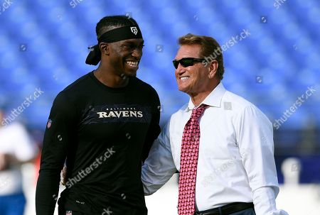 Week 13. Baltimore Ravens quarterback Robert Griffin III, left, chats with former Washington Redskins quarterback Joe Theismann before a preseason NFL football game between the Ravens and the Redskins, in Baltimore