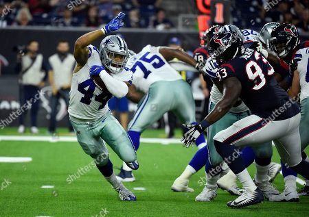 Darius Jackson, Joel Heath. Dallas Cowboys running back Darius Jackson (44) is chased Houston Texans defensive end Joel Heath (93) during the first half of a preseason NFL football game, in Houston