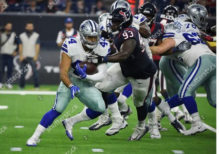 Darius Jackson, Joel Heath. Dallas Cowboys running back Darius Jackson (44) is stopped by Houston Texans defensive end Joel Heath (93) during the first half of a preseason NFL football game, in Houston