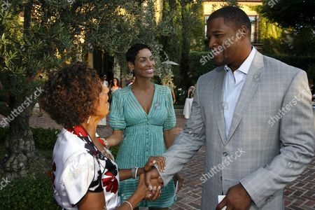 Dolores Robinson, Nicole Murphy and Michael Strahan