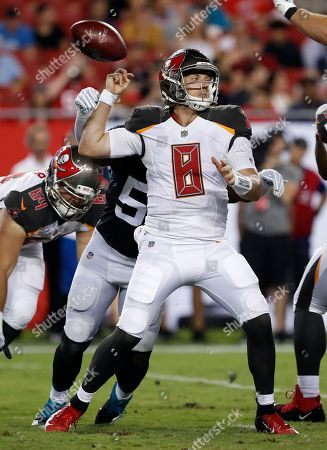 Tampa Bay Buccaneers quarterback Austin Allen (8) fumbles as he is hit by Jacksonville Jaguars linebacker Blair Brown (53) during the secoond half of an NFL preseason football game, in Tampa, Fla. Jacksonville recovered the fumble for a score